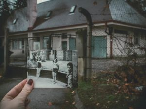 An old black and white photo resembles the house behind it