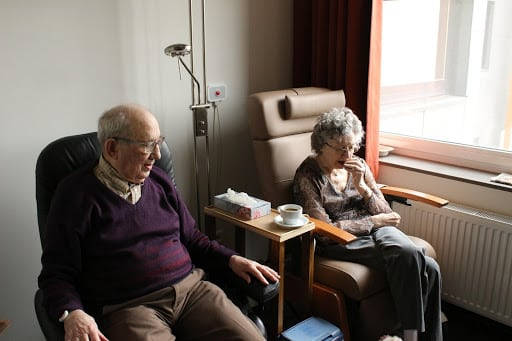 elderly couple in chairs