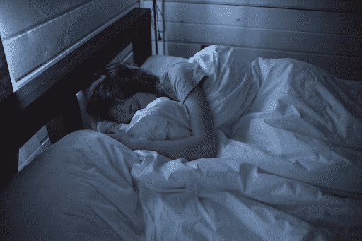 A woman sleeping in her bed