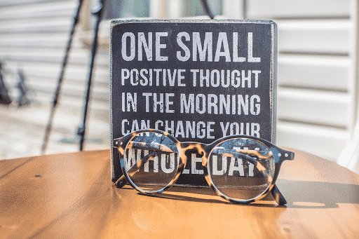 positive message with glasses in front